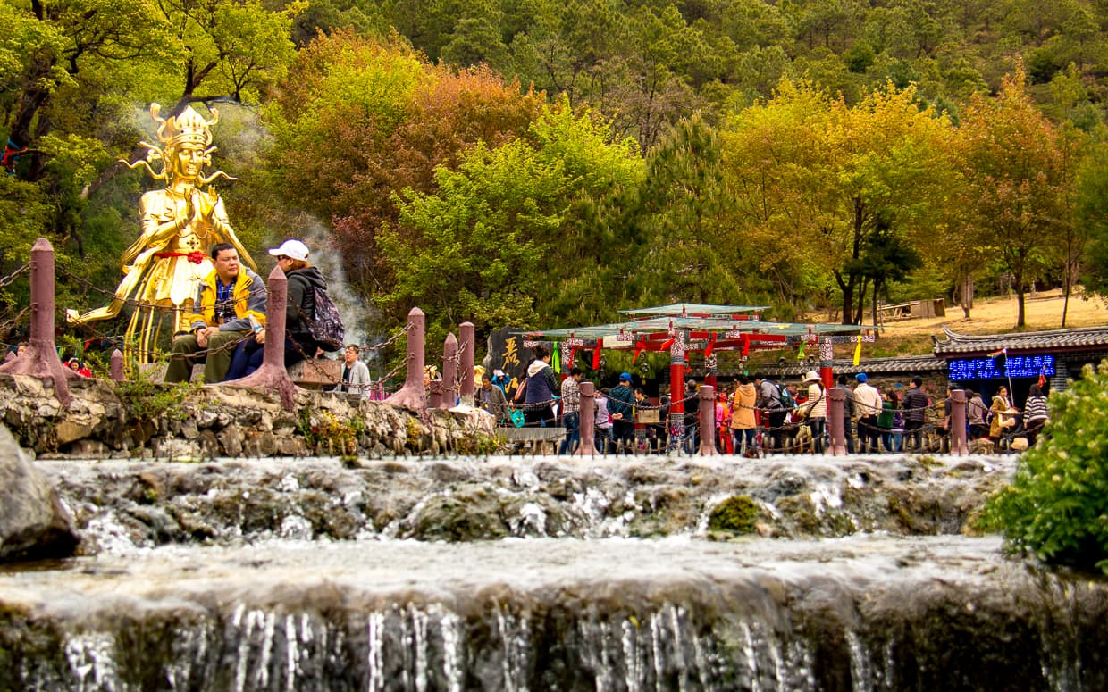 Waterfalls and statues in a park north of Lijiang, China.