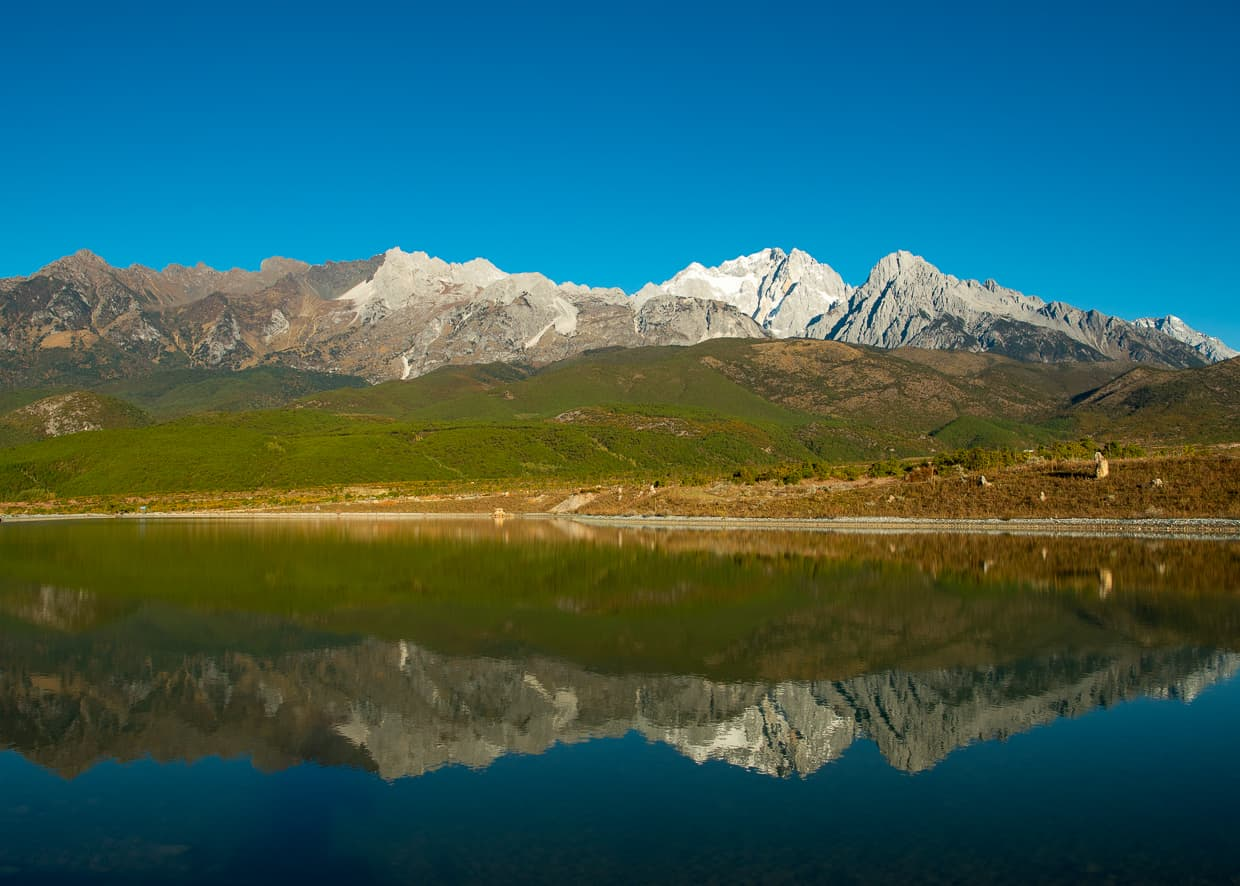 A reflection of the Jade Dragon Snow Mountain.
