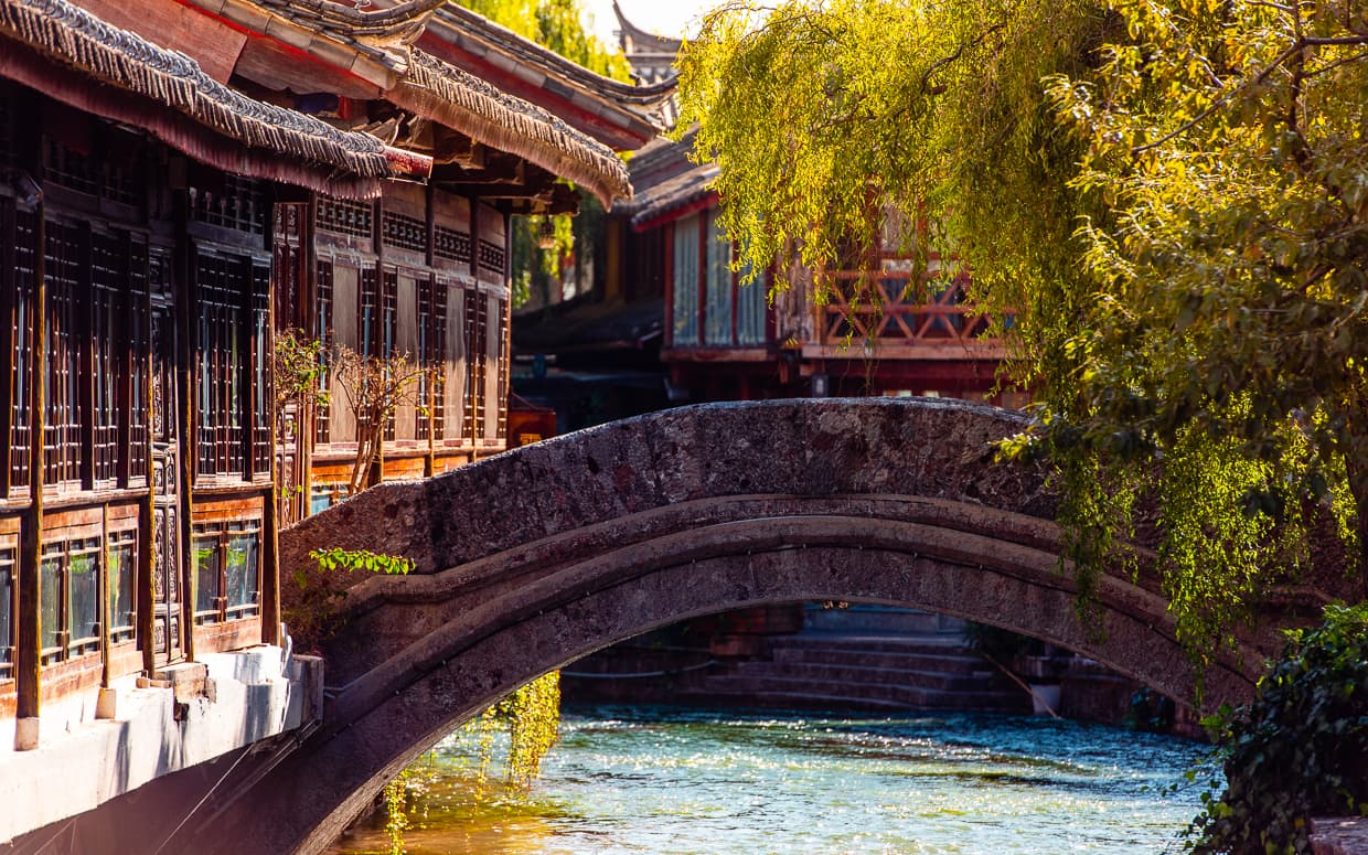 A bridge over a Lijiang Old Town river.