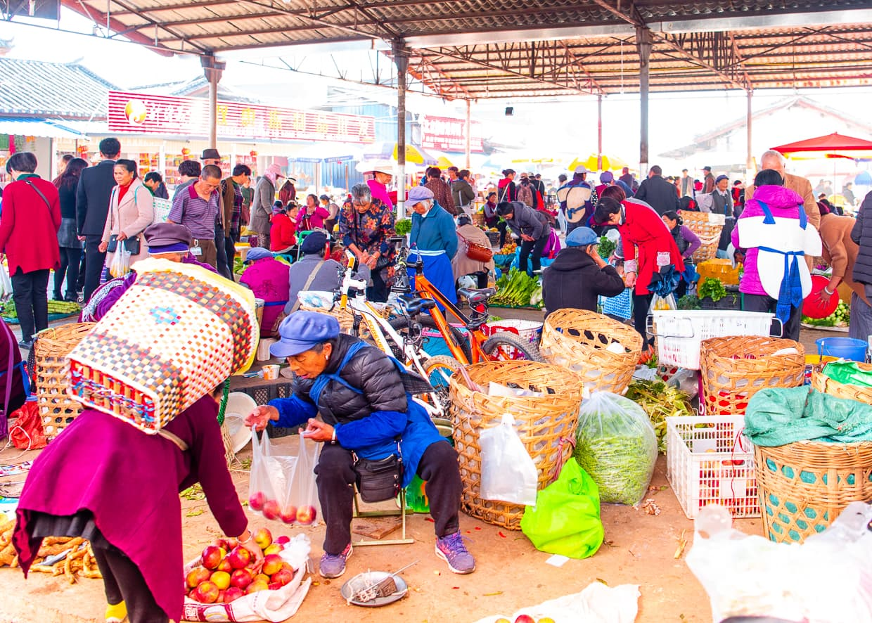 A busy produce market in the Lijiang Old Town.