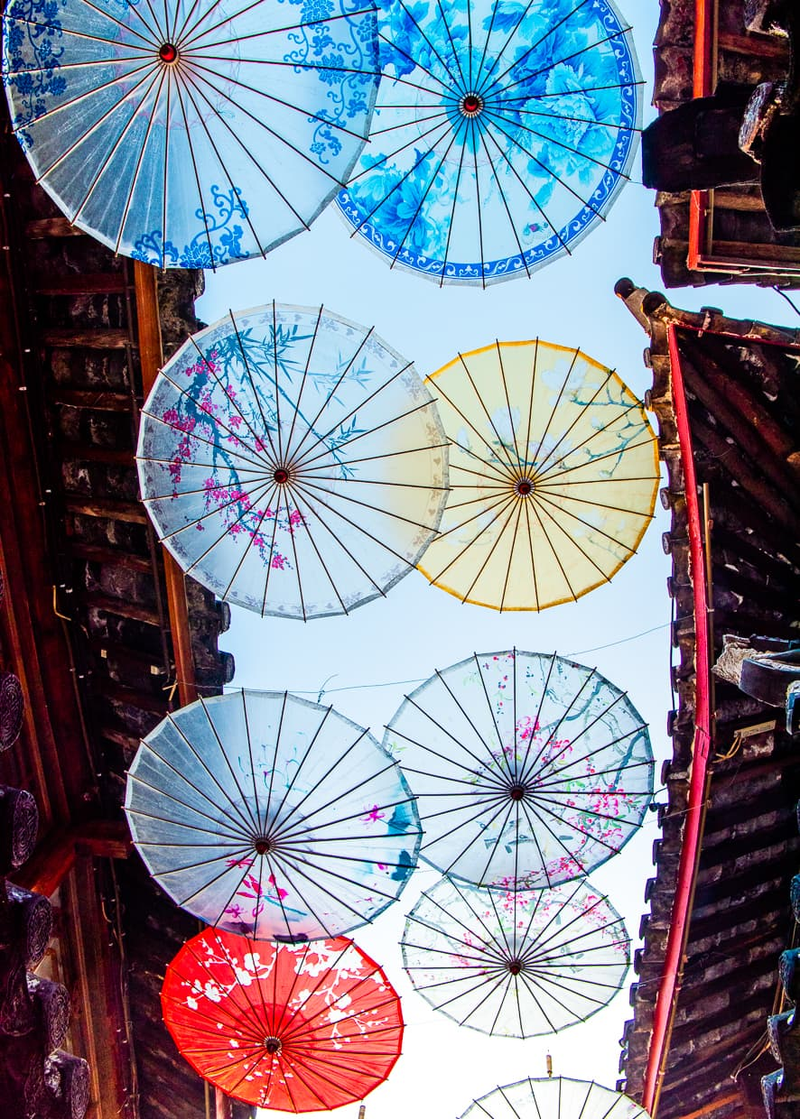 Umbrellas hanging over a street near the center of the Lijiang Old Town.