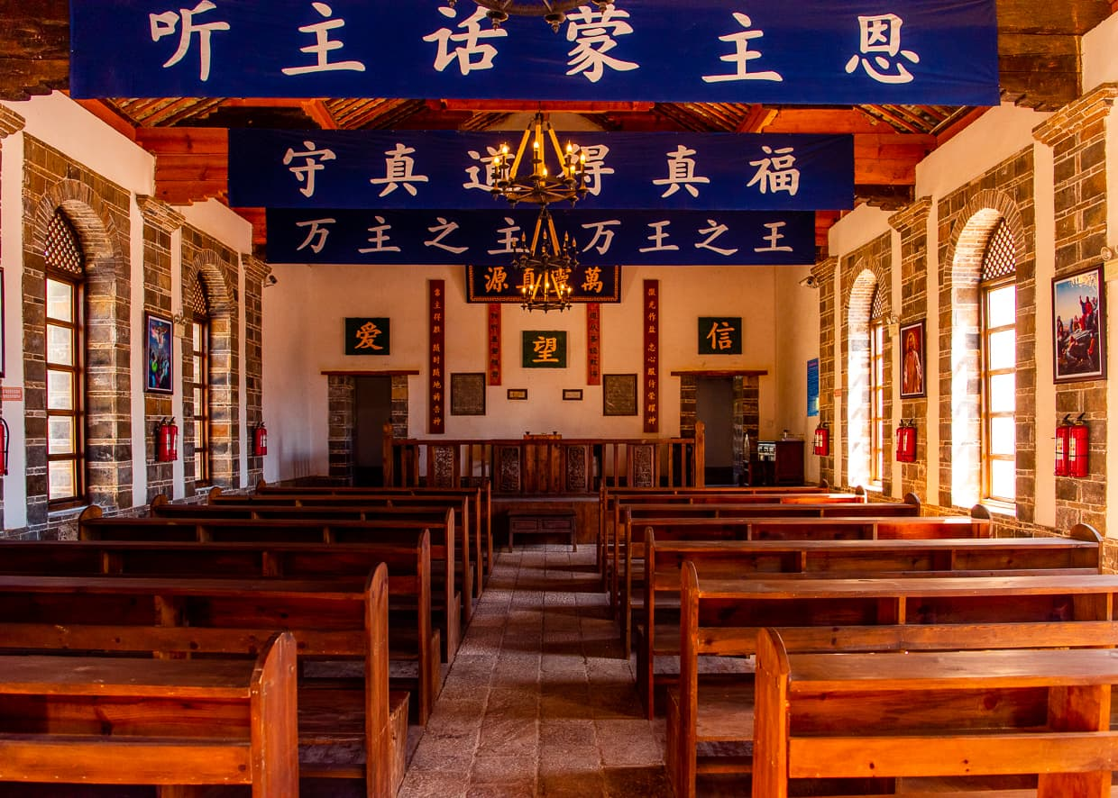 Pews of a church in the Lijiang, Old Town.
