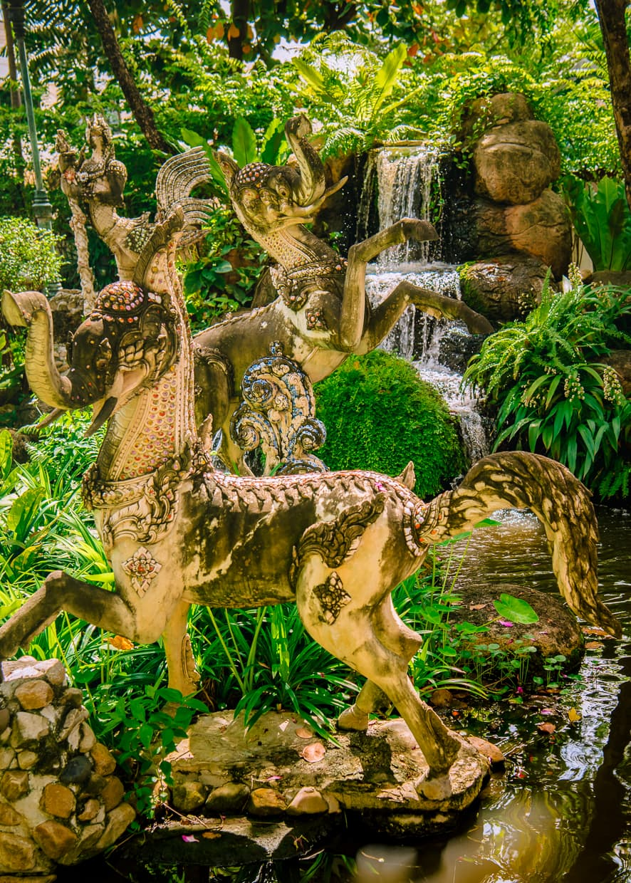 Demon statues in the gardens of the Erawan Museum in Bangkok, Thailand.