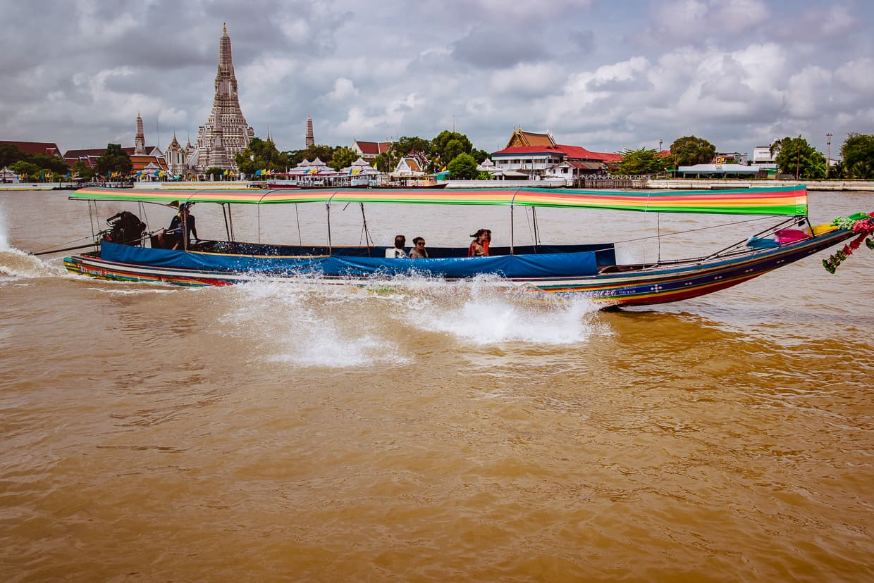 A boat on the river in front of Wat Arun.