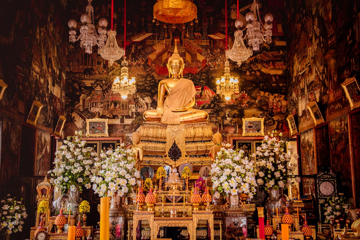 The Golden Buddha statue inside Wat Arun's Ordination Hall.