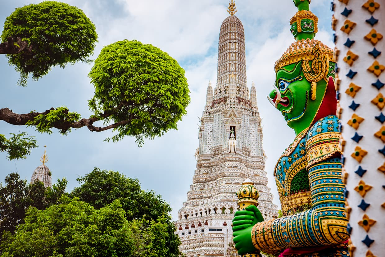 A statue guards Wat Arun in Bangkok, Thailand.