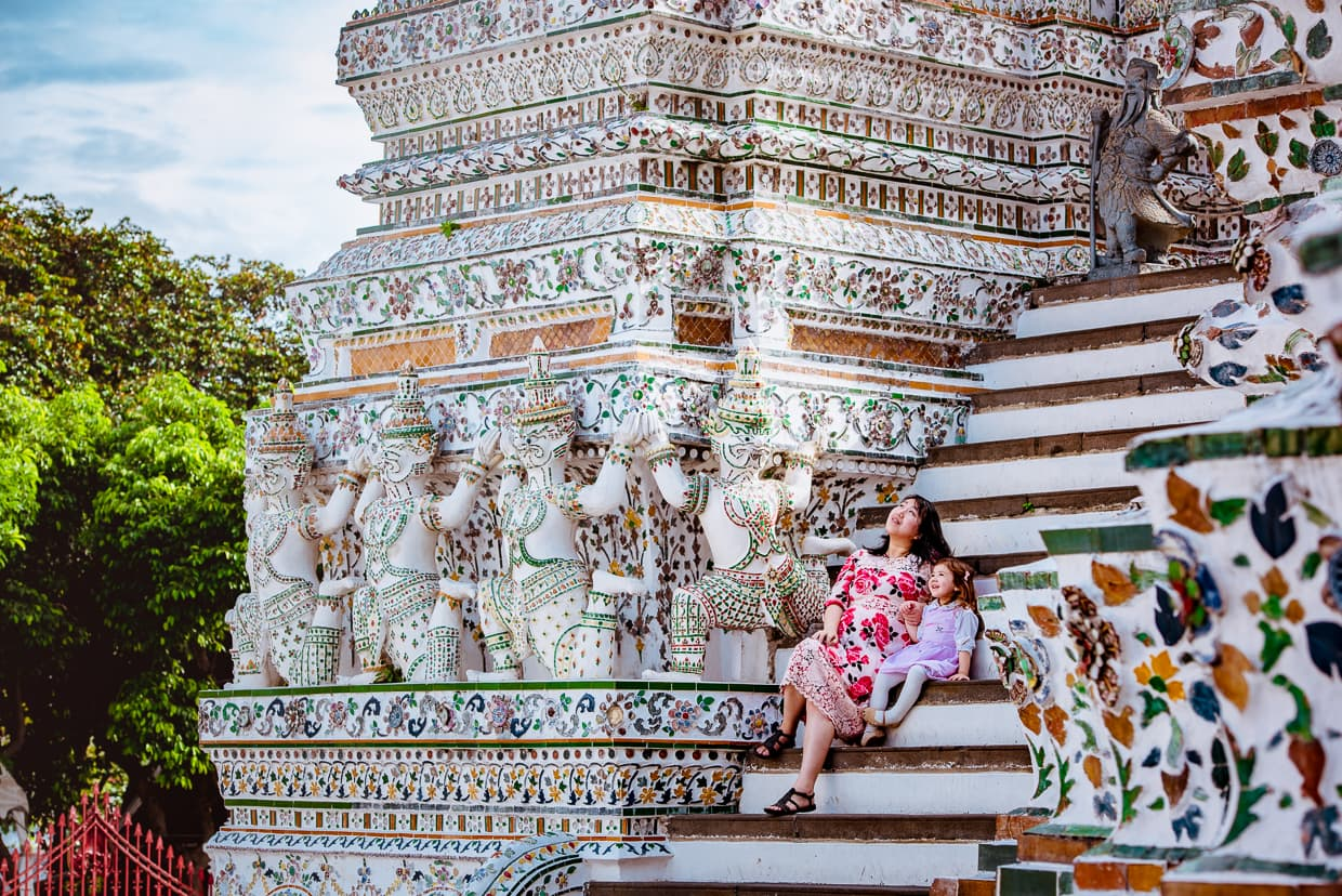 Dannie and Lisa sitting on the stairs of Wat Arun.
