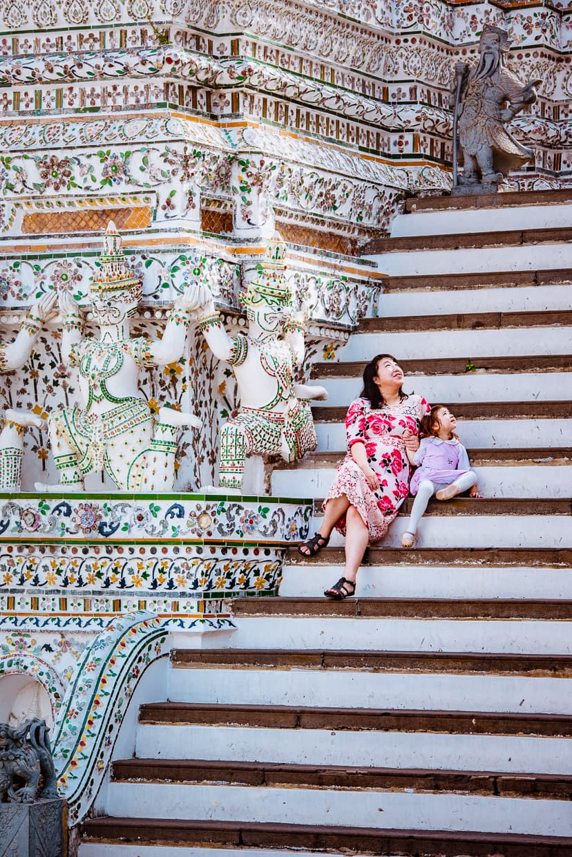 Sitting on the steps of Wat Arun in Bangkok, Thailand.