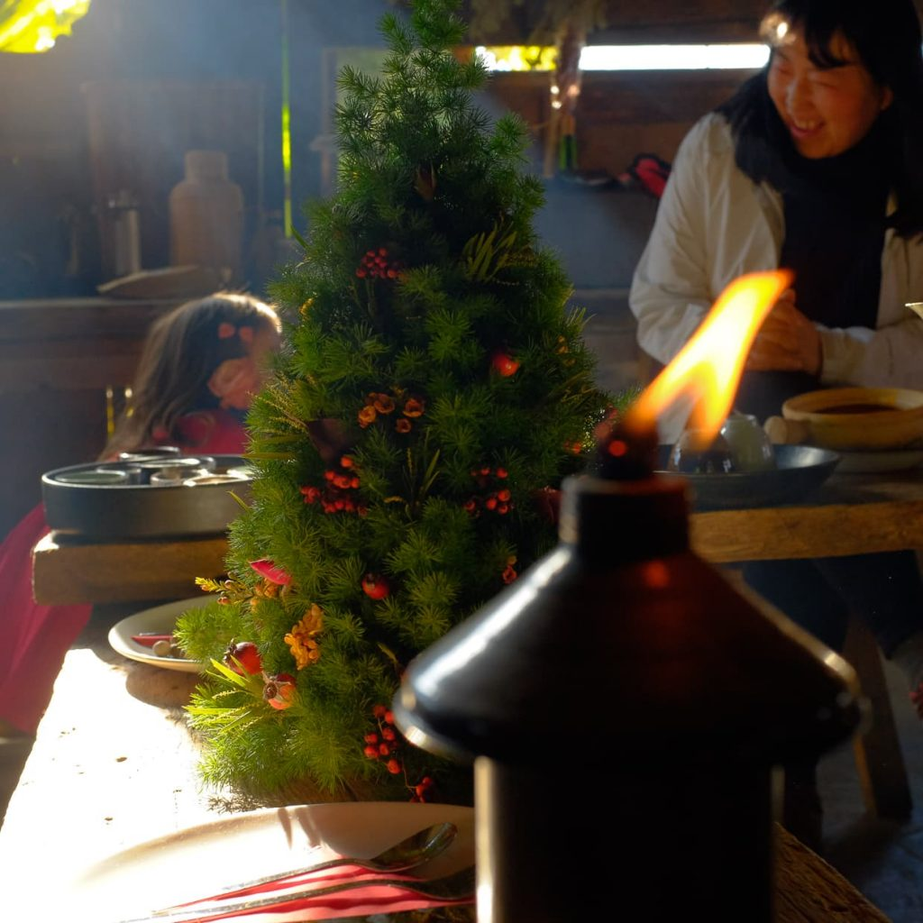 A candle and Christmas tree in Dali, China.
