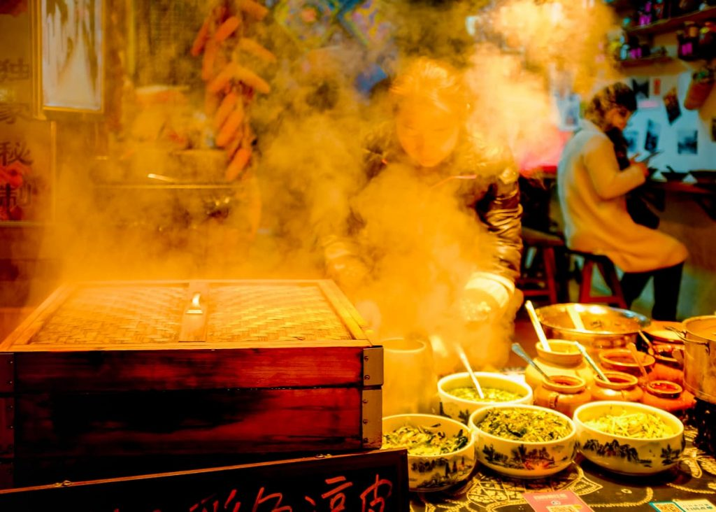 steam rising over street food in the Dali, China Old Town at night.