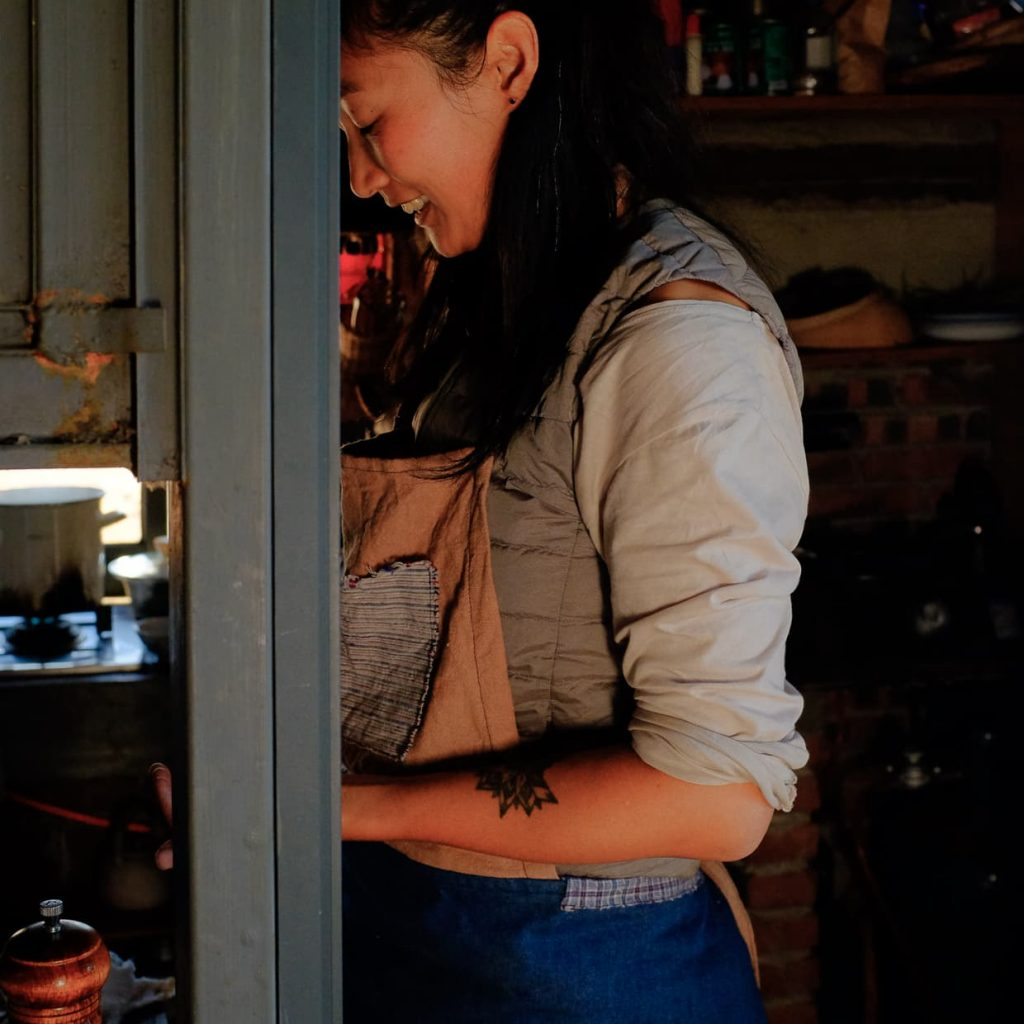 Li Li in the kitchen of her farmhouse.