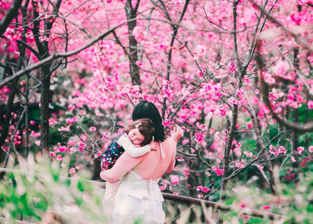 Mother and daughter with cherry blossoms in Dali, China.