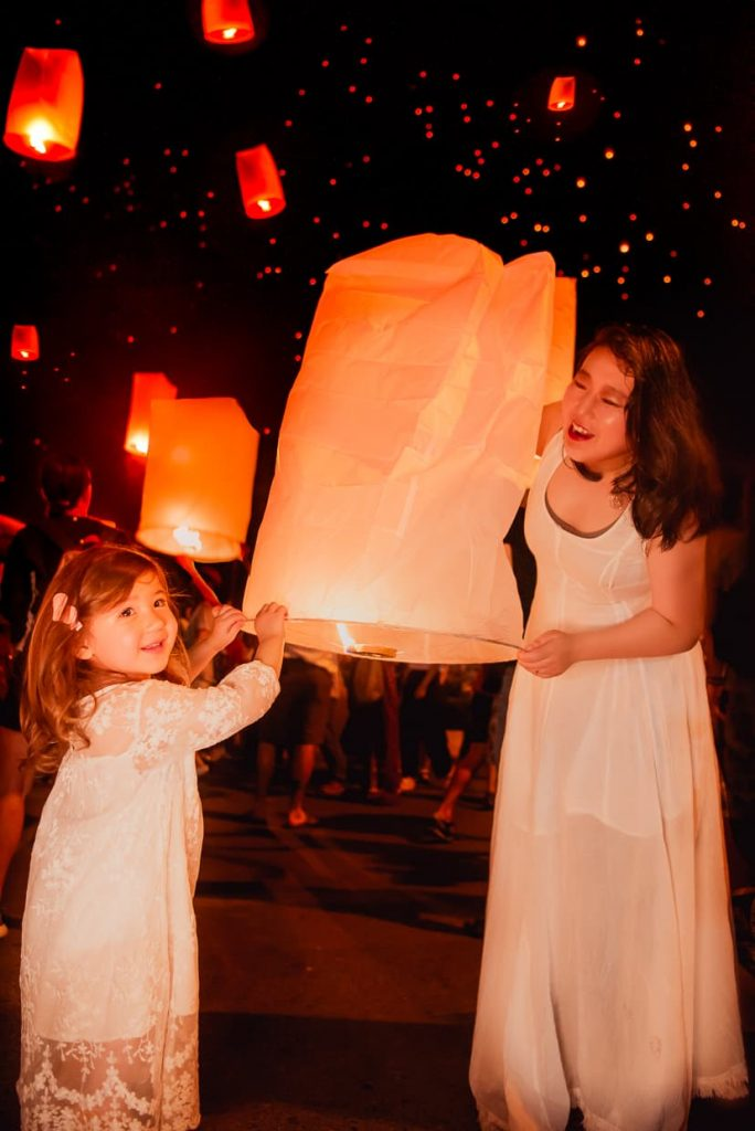 Mother and daughter lantern sendoff in Chiang Mai, Thailand.