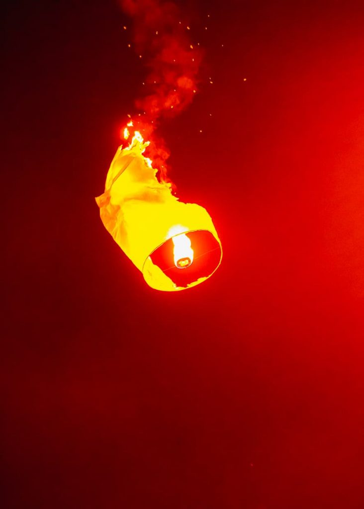 A falling lantern in flames over Chiang Mai.