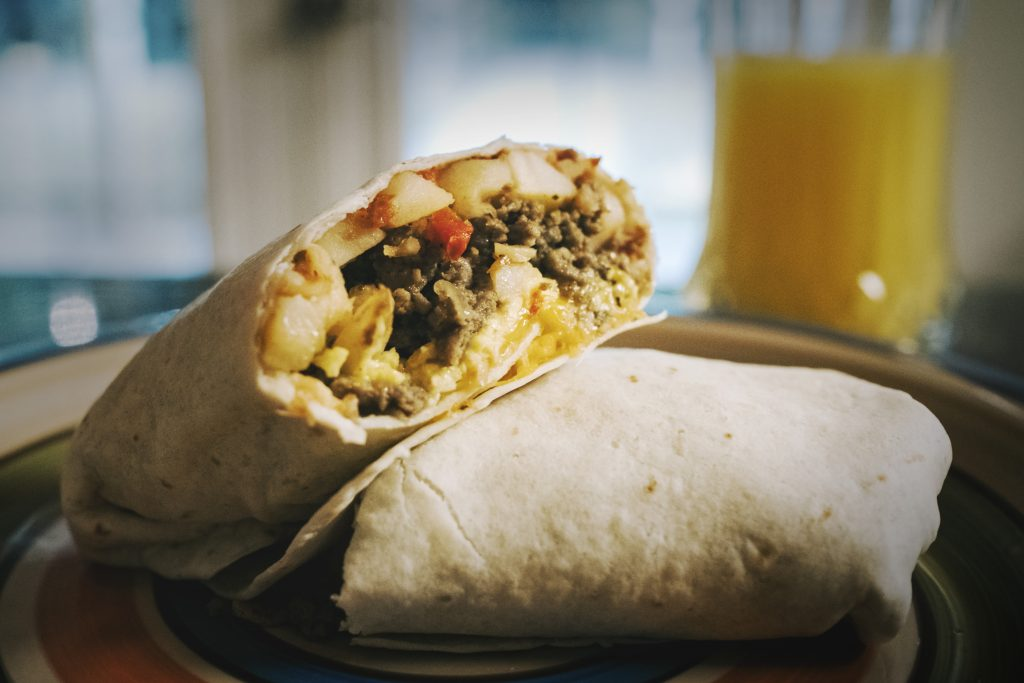 A Breakfast Burrito Cut in Half-Pixrly.com