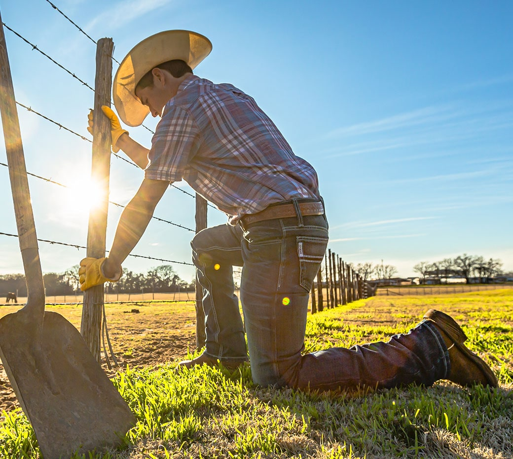 Rancher fixing a fence.