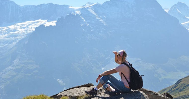 female hiker enjoying mountain view