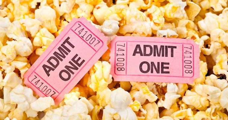 movie tickets on buttered popcorn