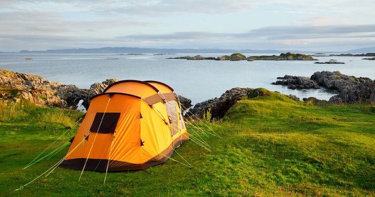 orange tent camping in Scotland