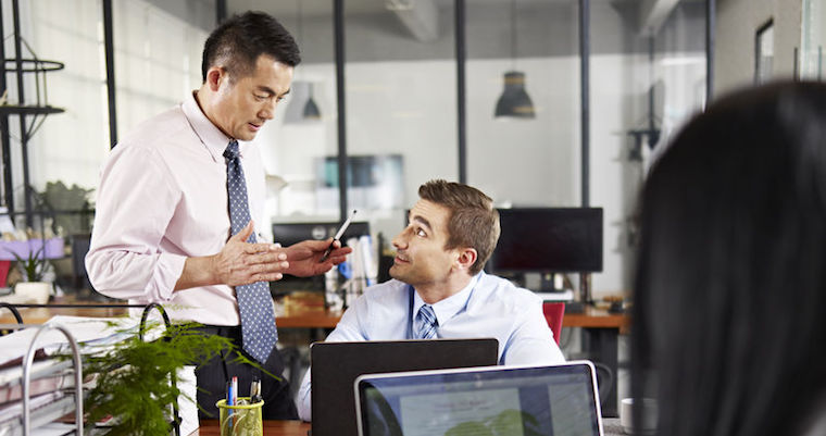 businessman explaining something to a colleague in a modern office