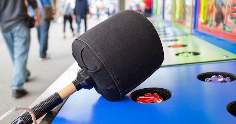 what-a-mole arcade game with large black mallet
