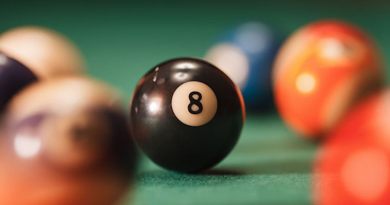black 8 ball on a pool table