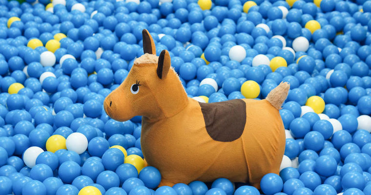 stuffed horse in a ball pit