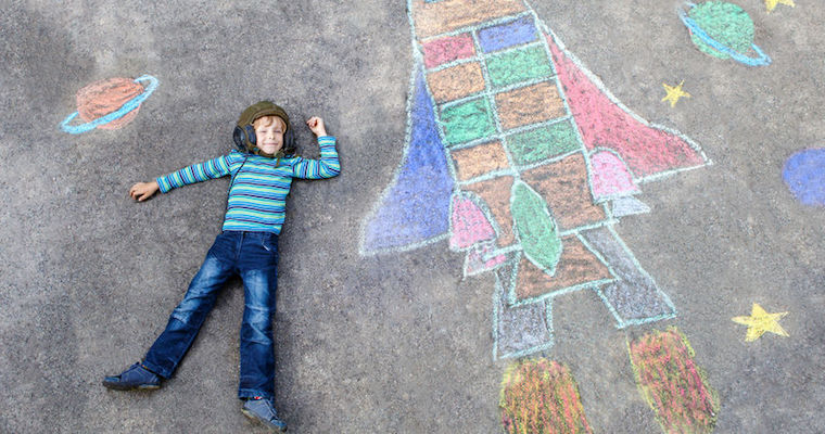boy chalk drawing of a rocket ship