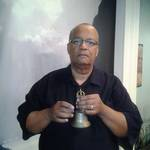 Lawrence Toliver rings the meditation bell to begin each Meditation for Peace in Charlotte.