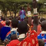 Maandag speaks to a group of women in Ormanie where PWC and Global Partners have built a school <span>&copy; Amy Holter </span>