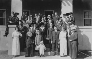 Celebratory Banquet at the Marconi Hotel; Ruth Sayers stands towards the center on the lower step, with a broad white collar and black hat; her new husband, Adolph Rau, stands next to her