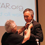 Dennis Kucinich Given Peace Pioneer Pin by Dept. of Peacebuilding Group
