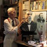 Sculptor Howard Lazar working on bust of Peter Donahue