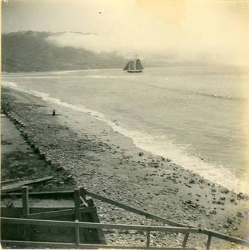 The Jennie Griffin, in transit from San Francisco, is preparing to cross the bar.This view illustrates the likely condition of Bolinas Beach, when the schooner Almy met her fate.  Note the skiff being towed behind. <span>&copy; John Page </span>