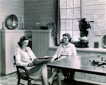 Nancy (left) & Martye Kent inside family home in the remodeled Kent family barn in Kent Woodlands, 1940s <span>© Anne T. Kent Room </span>