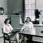 Nancy (left) & Martye Kent inside family home in the remodeled Kent family barn in Kent Woodlands, 1940s