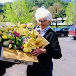 Nancy Kent Danielson delivering Easter flowers to the Greenbrae Care Center from the Marin Garden Club, 2007 <span>© Anne T. Kent Room </span>