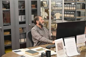 Dewey Livingston at the Map & Special Collections Annex. <span>&copy; Anne T. Kent Room </span>