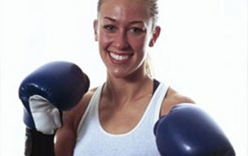 Laura wearing boxing gloves.
