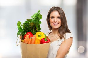 Photo of woman holding groceries