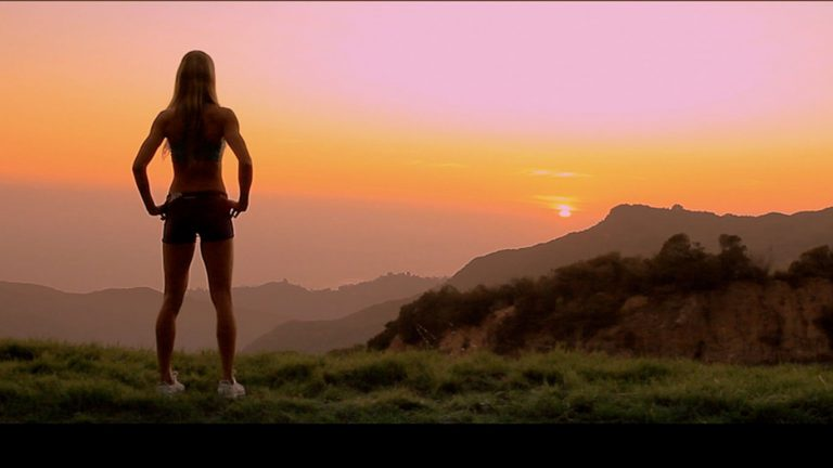 A background image showing Laura looking at sunset