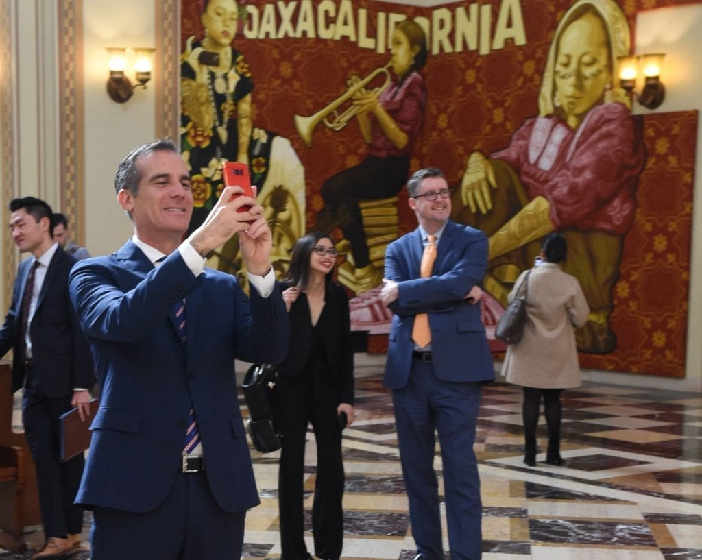 Mayor Eric Garcetti takes in the murals at Central Library.