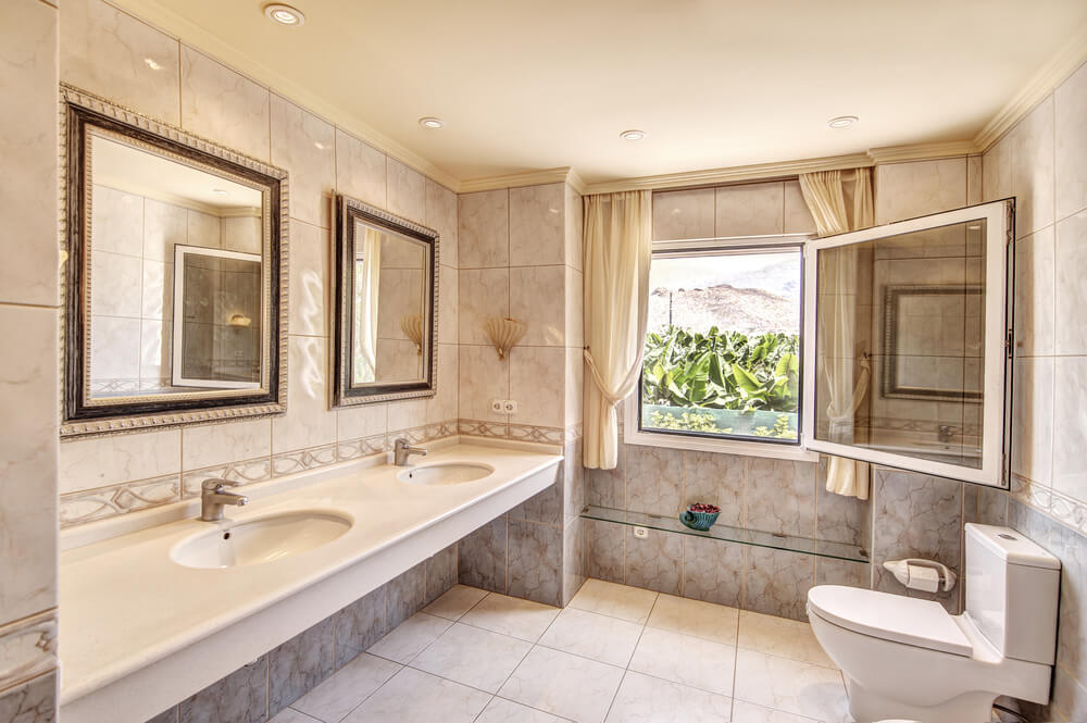 Tile from floor to ceiling, with two mirrors with matching frames adds a hint or richness.