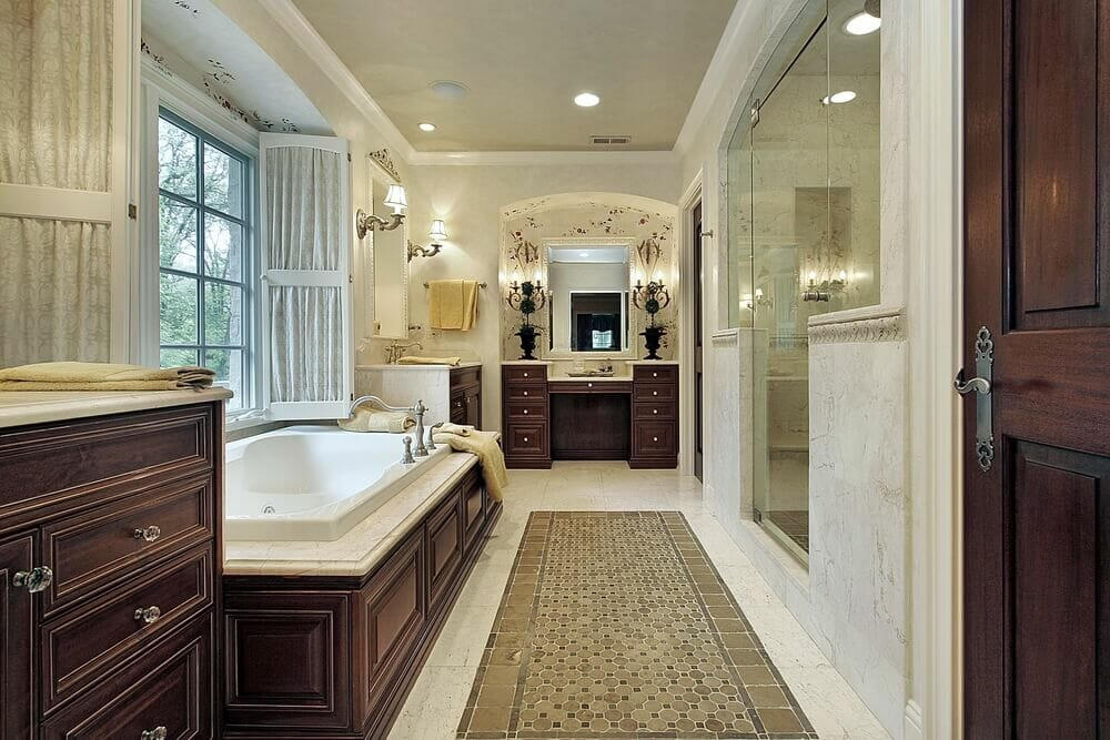 Nice cabinet designs on both sides of the bathroom. Lamps and windows make it a beautiful presentation all together.
