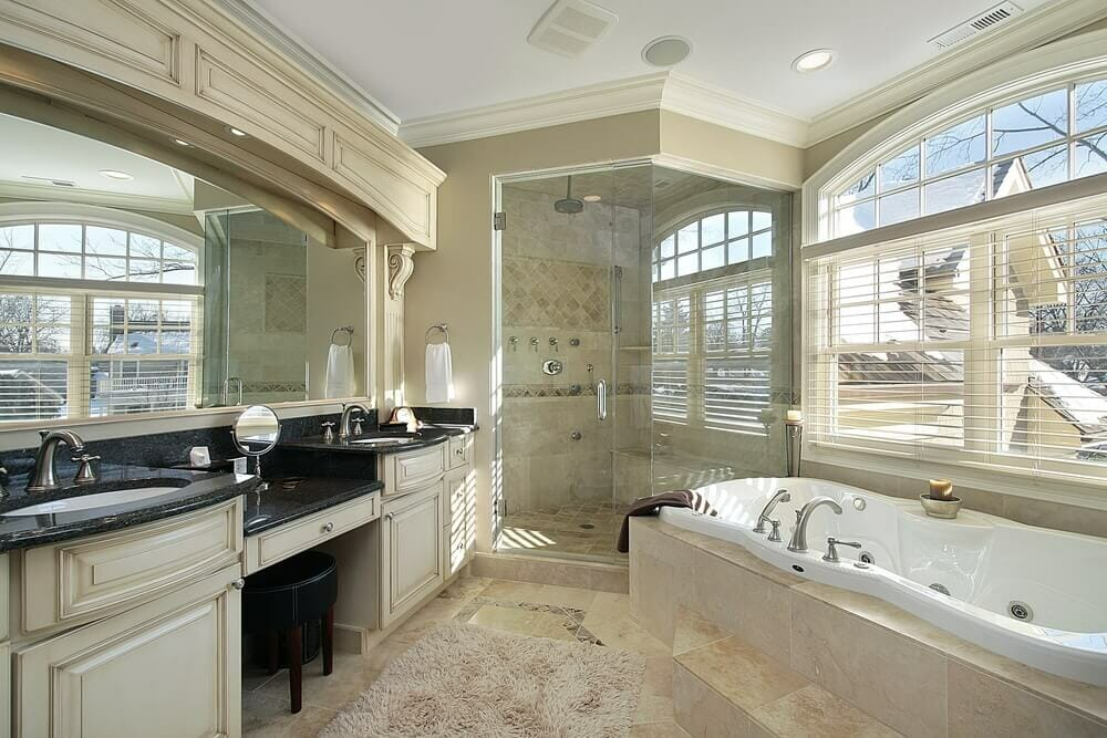 This amazing design with bath tub and a standing shower maximizes the size of the room . The cabinetry and crown moulding really help to set this room apart.