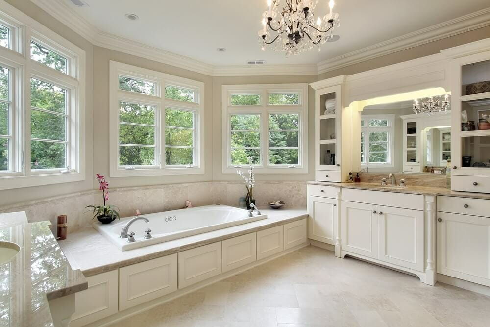White rooms are still the rage. We love the mirror light coming from the upper cabinetry.