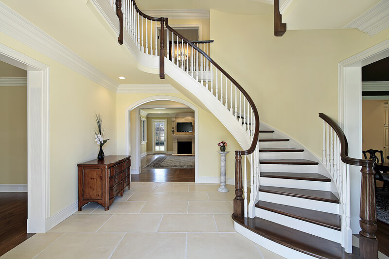 Foyer with curved staircase in new construction home