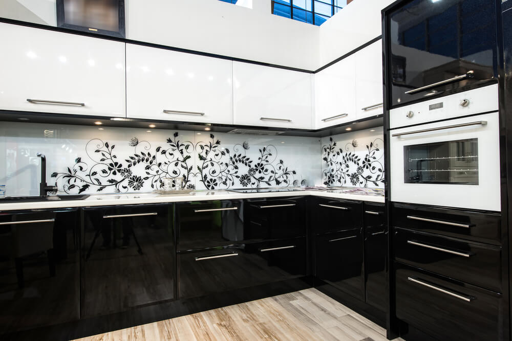 Black and white doesn't have to be boring: try adding an interesting pattern to your backsplash to make your black and white kitchen more lively.