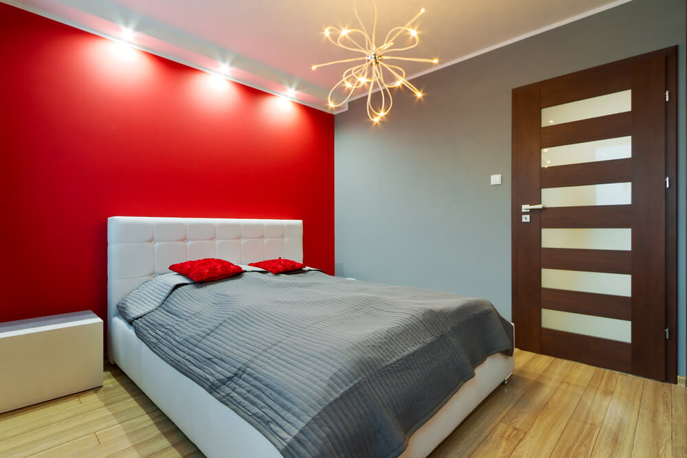 An accent wall and interesting light fixture can add a lot of personality to your master bedroom.