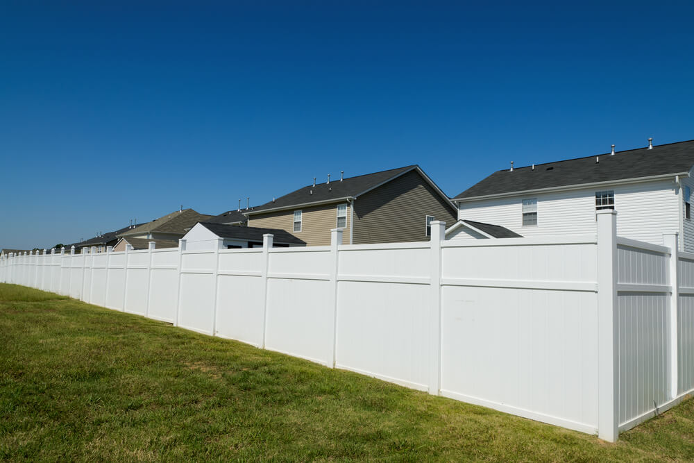 This large white vinyl privacy fence is a great balance between esthetics and function in man made fencing.